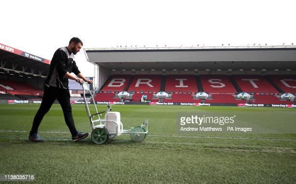 Groundsman prepares the pitch before the Sky Bet Championship match at Ashton Gate Stadium, Bristol.