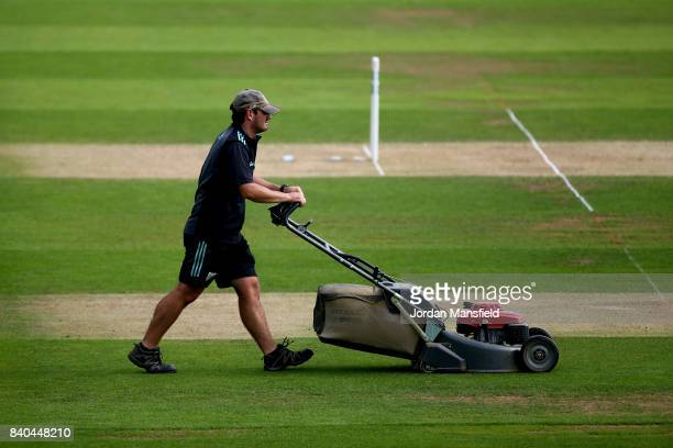 A groundsman prepares the pitch prior to the start of play on day two of the Specsavers County Championship Division One match between Surrey and...