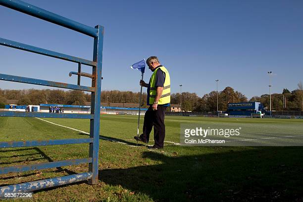 Groundsman putting a corner flag into the ground at Lancaster City's Giant Axe ground prior to the club's FA Cup third qualifying round match against...
