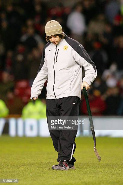 A groundsman repairs the pitch at half time during the Barclays Premiership match between Manchester United and Portsmouth at Old Trafford on...