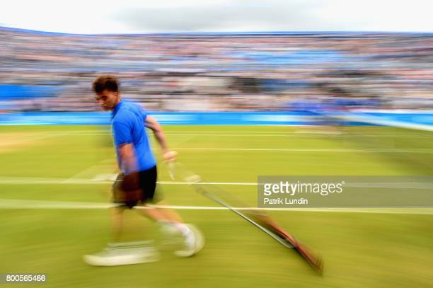 A groundsman sweeps the court on day six of the 2017 Aegon Championships at Queens Club on June 24 2017 in London England