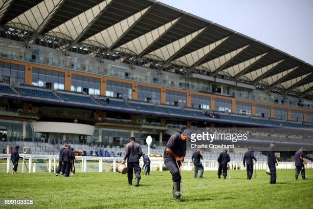 Groundsman tend to the final furlong as they prepare for the days racing ahead during day 2 of Royal Ascot at Ascot Racecourse on June 21 2017 in...