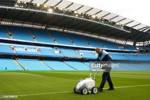 Groundsman tends to the pitch prior to the Premier League match between Manchester City and Watford FC at Etihad Stadium on March 09, 2019 in...