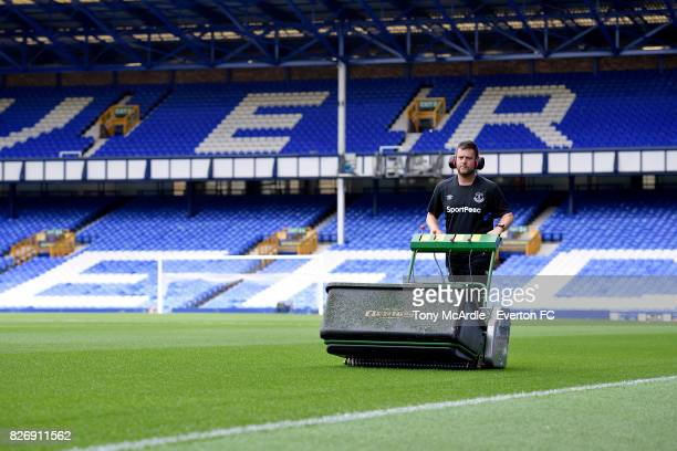 Groundsman Tony Balshaw prepares the pitch before the Pre Season Friendly match between Everton and Sevilla at Goodison Park on August 6 2017 in...