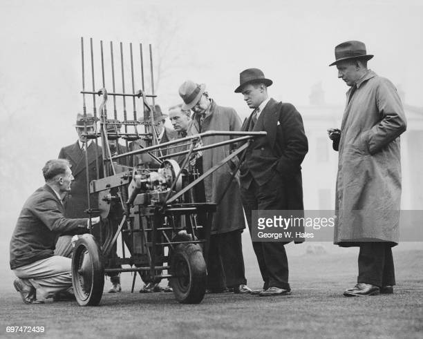 Groundsman view a demonstration of a turf aeration machine for tennis courts cricket pitches and croquet lawns during a National Association of...