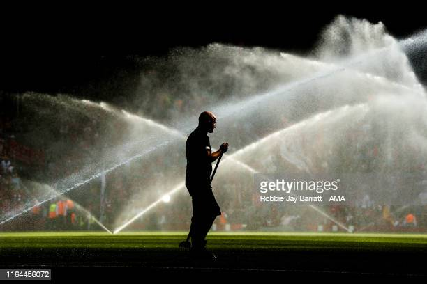 Groundsman waters the pitch during the Premier League match between Liverpool FC and Arsenal FC at Anfield on August 24, 2019 in Liverpool, United...