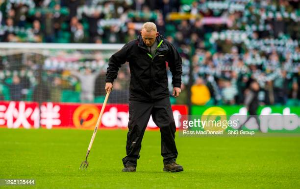 Groundsman work on the Celtic pitch