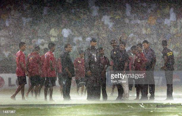 Groundsmen bring on the covers in the torrential rain during the India v Sri Lanka Final of the ICC Champions Trophy at the R Premadasa Stadium...