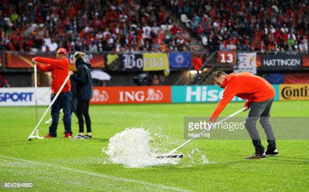 Groundsmen clear water from the pitch after heavy rain prior to the UEFA Women's Euro 2017 Quarter Final match between Germany and Denmark at Sparta...
