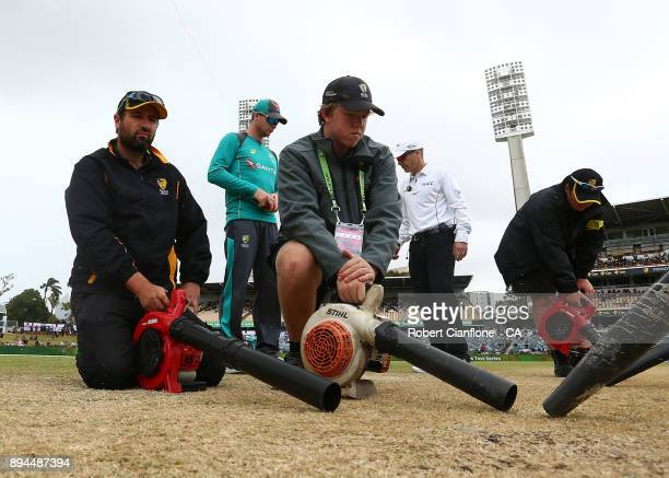 Groundsmen dry the pitch during day five of the Third Test match during the 2017/18 Ashes Series between Australia and England at the WACA on...