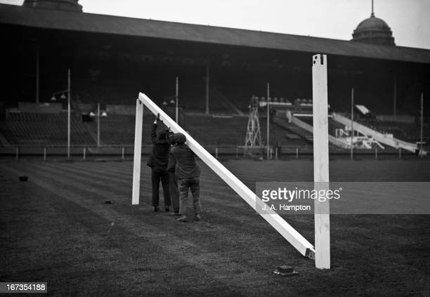 Groundsmen erecting a goalpost in preparation for an FA Cup tie at Wembley Stadium London 29th April 1937