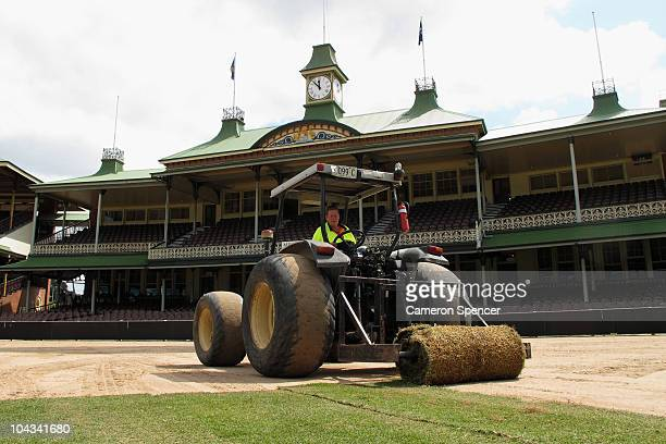 Groundsmen lay down new turf at Sydney Cricket Ground on September 22 2010 in Sydney Australia For the first time in 150 years the entire ground is...