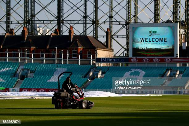 Groundsmen make the final preparations to the pitch ahead of the Specsavers County Championship Division One match between Surrey and Warwickshire at...