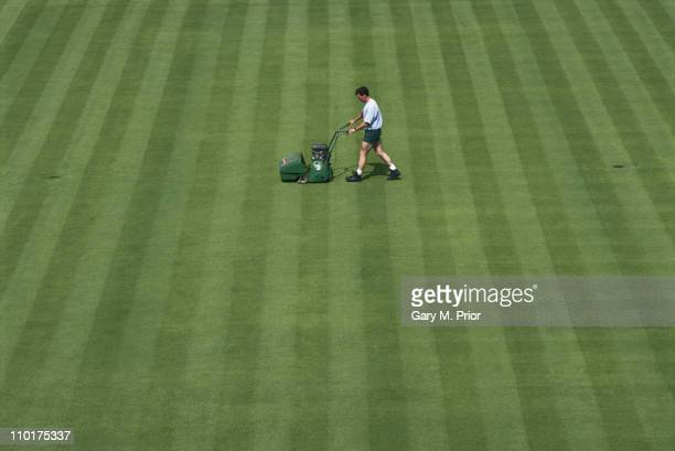 Groundsmen mow the Centre Court grass with a lawnmower in preparation for the Wimbledon Lawn Tennis Championships on 1st June 1995 at the All England...