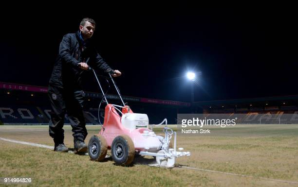 Groundsmen paint the white lines prior to The Emirates FA Cup Fourth Round match between Rochdale AFC and Millwall at Spotland Stadium on February 6...