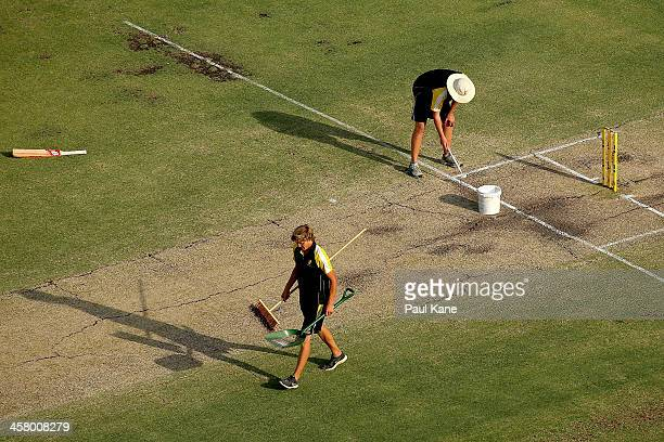 Groundsmen repaint the crease during day four of the Third Ashes Test match between Australia and England at The WACA on December 16 2013 in Perth...