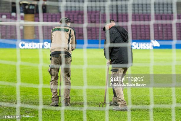 Groundsmen work on the pitch prior to the UEFA Euro 2020 qualifier between Switzerland and Republic of Ireland on October 15 2019 in Geneva...
