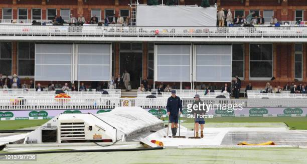 Groundstaff at work as the rain continues to fall during day one of the 2nd Specsavers Test Match between England and India at Lord's Cricket Ground...