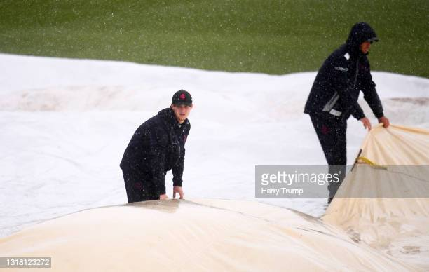 Groundstaff bring on the covers as rain delays play during Day Three of the LV= Insurance County Championship match between Somerset and Surrey at...