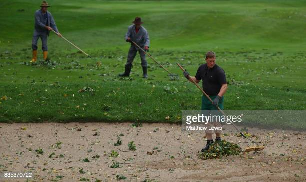 Groundstaff clear debris of trees after a storm in the evening delays play ahead of day three of the Saltire Energy Paul Lawrie Matchplay at Golf...
