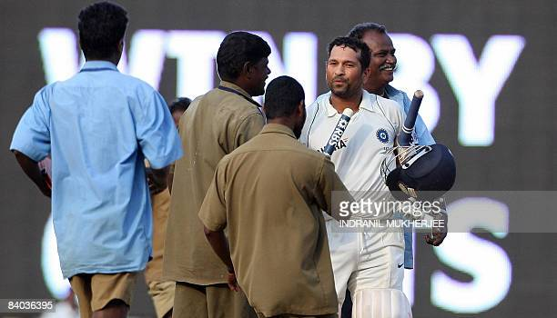 Groundstaff greet Indian cricketer Sachin Tendulkar after India's win on the last day of the first Test between India and England at the M.A....