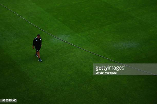Groundstaff inspect the pitch as rain abandons play during the Royal London OneDay Cup match between Surrey and Sussex at The Kia Oval on May 29 2018...