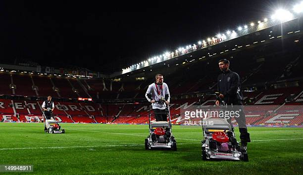 Groundstaff maintain the pitch after the London 2012 Olympic men's football semi final match between Brazil and South Korea at Old Trafford in...