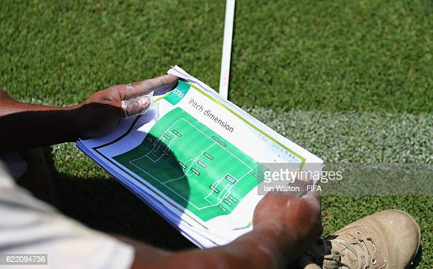 Groundstaff measure out the football pitch lines ahead of the FIFA U20 Women's World Cup Papua New Guinea 2016 at the Sir John Guise Stadiumon...
