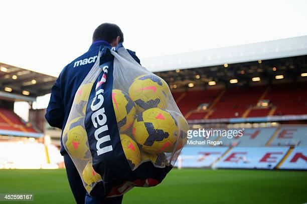 Groundstaff member takes training balls out onto the pitch before the Barclays Premier League match between Aston Villa and Sunderland at Villa Park...