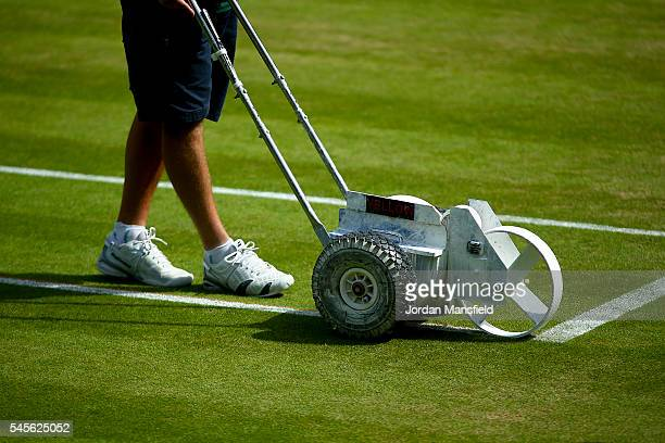 Groundstaff prepare Centre Court ahead of the Women's Final match between Serena Williams of the USA and Angelique Kerber of Germany on day twelve of...