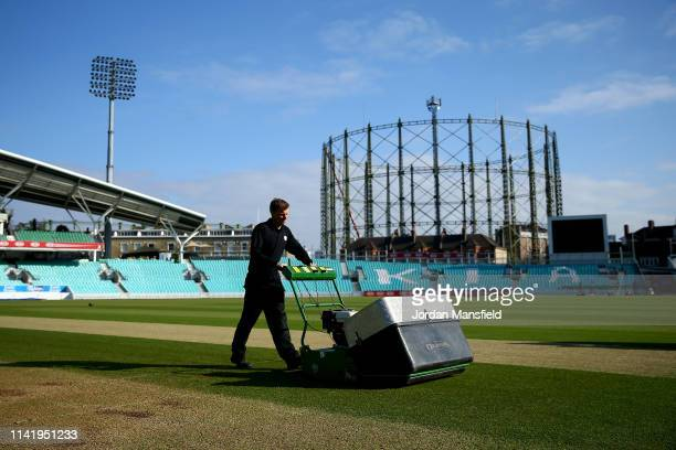 Groundstaff prepare the field ahead of the start of day one of the Specsavers County Championship Division 1 match between Surrey and Essex at The...