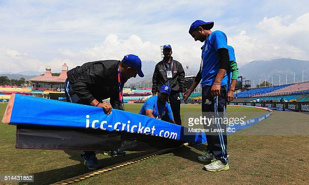 Groundstaff prepare the pitch ahead of the ICC Twenty20 World Cup match between Bangladesh and Netherlands at HPCA Stadium on March 9 2016 in...