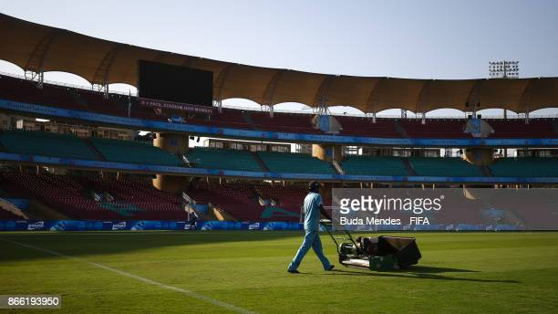 Groundstaff prepare the pitch ahead the FIFA U17 World Cup India 2017 Semi Final match between Mali and Spain at Dr DY Patil Cricket Stadium on...