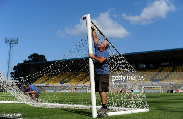 Groundstaff prepare the practice goals prior to kick off during the PreSeason Friendly match between Torquay United and Cardiff City at Plainmoor...