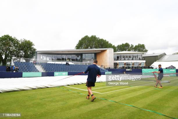 Groundstaff pull the covers on as rain delays play during the Ilkley Trophy Day One at Ilkley Lawn Tennis Squash Club on June 17 2019 in Ilkley...