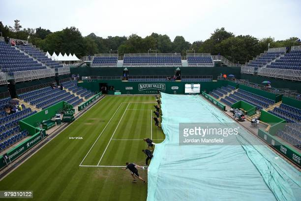 Groundstaff pull the covers on as rain delays play on Day Five of the Nature Valley Classic at Edgbaston Priory Club on June 20 2018 in Birmingham...