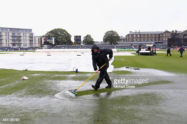 Groundstaff sweep away puddles from the outfield in vain as play is abandoned in the first Royal London OneDay Series match between England and India...
