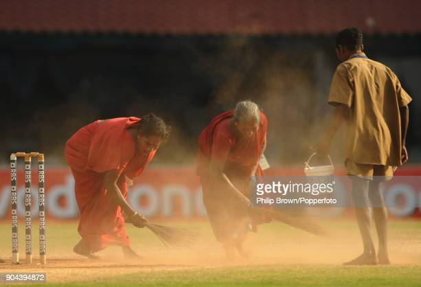 Groundstaff sweep the wicket during a drinks break in the 1st Test match between India and England at MA Chidambaram Stadium Chennai India 14th...