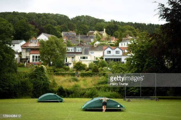 Groundstaff work on the pitch at Uplyme & Lyme Regis Cricket Club prior to the club taking part in a training session in a group of 6 on July 05,...