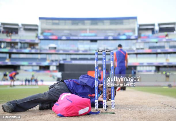 Groundstaff work on the square and stumps during the Group Stage match of the ICC Cricket World Cup 2019 between Bangladesh and India at Edgbaston on...