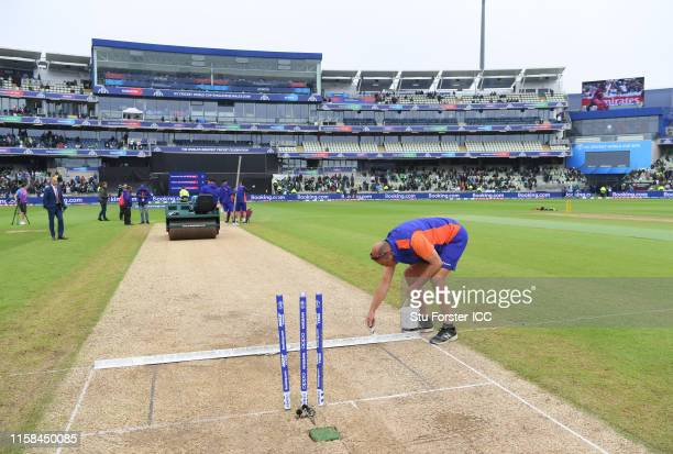 Groundstaff work on the square during the Group Stage match of the ICC Cricket World Cup 2019 between New Zealand and Pakistan at Edgbaston on June...