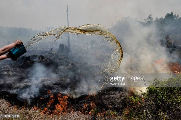 Groundwater is used to help put out a peatland fire in Pekanbaru Riau province on February 1 one of 73 detected hotspots causing haze on the island...