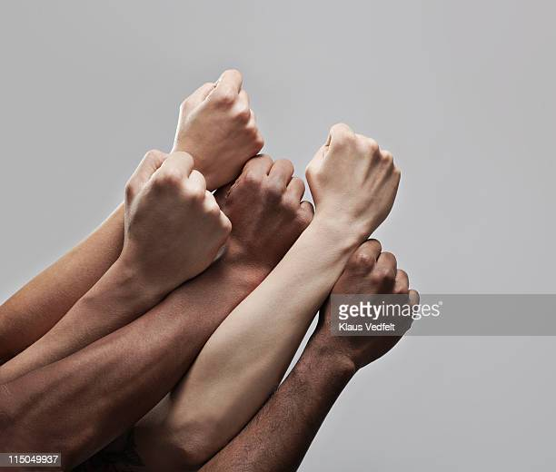 group 5 fists hold closely together - kracht stockfoto's en -beelden
