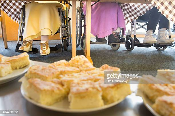A group 90 year old residents sitting in their wheelchairs having cake at the table at a nursing home pictured on October 16 2013 on the island of...