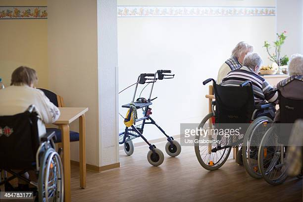 A group 90 year old residents sitting in their wheelchairs having lunch at the table at a nursing home pictured on October 16 2013 on the island of...