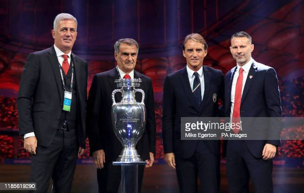 Group A, Switzerland manager Vladimir Petkovic , Turkey manager Senol Gunes , Italy manager Roberto Mancini and Wales manager Ryan Giggs during the...