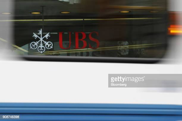 Group AG logo is seen through the window of a passing tram outside a UBS bank branch in Zurich Switzerland on Monday Jan 22 2018 A UBS loan backed by...