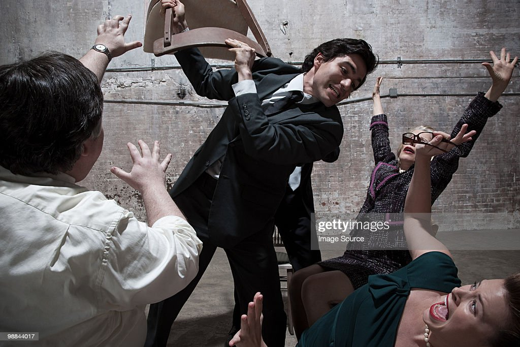 Group arguing in warehouse : Stock Photo