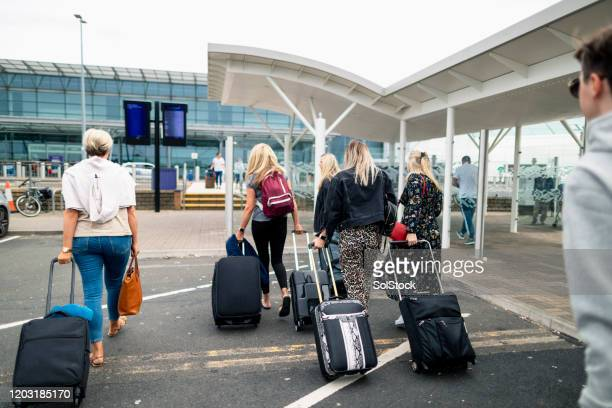 group arriving at the airport - airfield stock pictures, royalty-free photos & images
