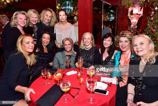 Group attends A Christmas Cheer Holiday Party 2017 Hosted by George Farias and Anne and Jay McInerney at The Doubles Club on December 14 2017 in New...